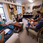 Margaret Murnane and team members discussing a project in her office