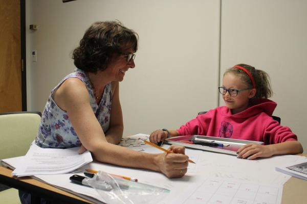 Teacher working with Child during summer camp