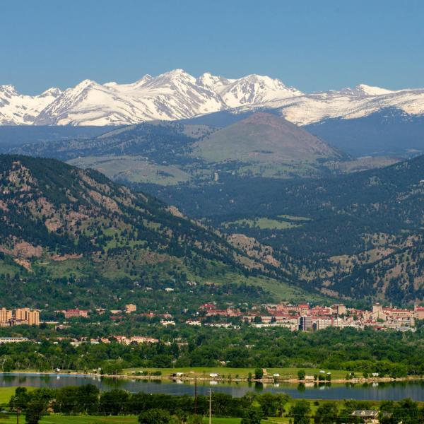 Picture of CU Boulder with snowy mountains in the background
