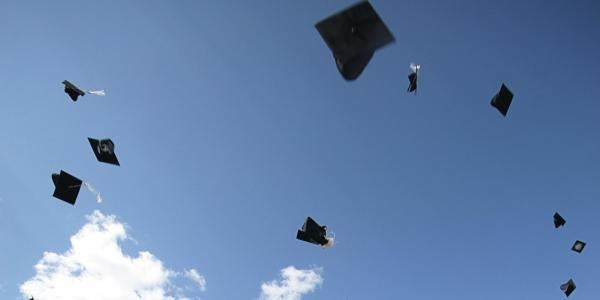 Graduation hats thrown in the sky