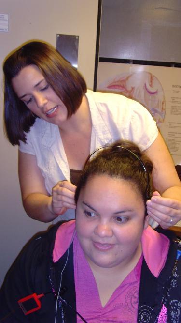 Woman testing hearing