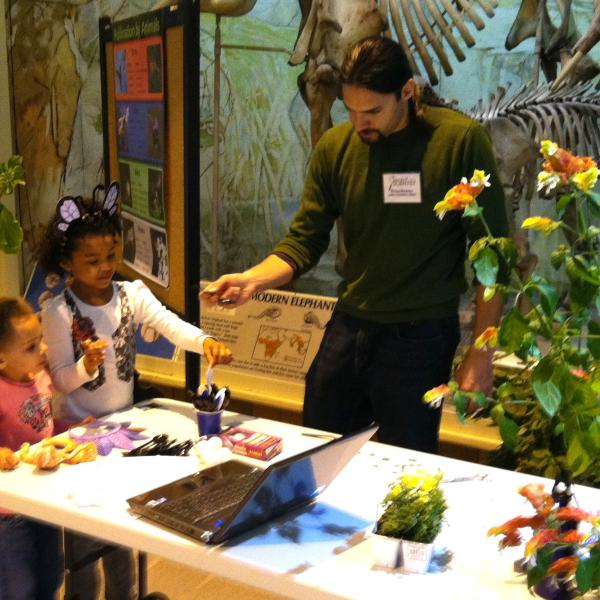 Nathan explains how plants often depend on bats, birds or insects to pollinate their flowers.Sunday with a Scientist at the State Museum, April 17, 2011