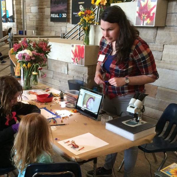 Chelsea teaching about flowers at CU South Family Fun Day, 2017