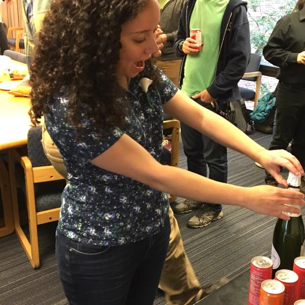 Julia popping the champagne after her exit talk, 2017