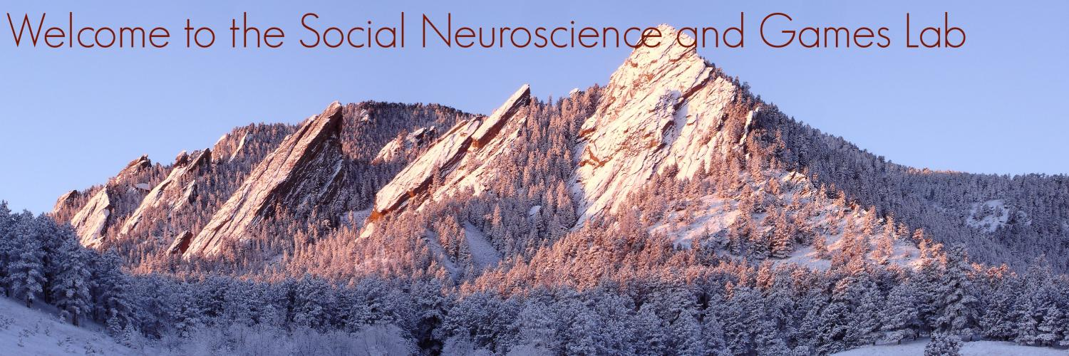 """Snowy Flatirons with welcome text, """"welcome to the Social Neuroscience and Games lab"""""""