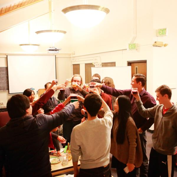 cheers during a holiday party in fall 2015 on the top of the Gamow tower