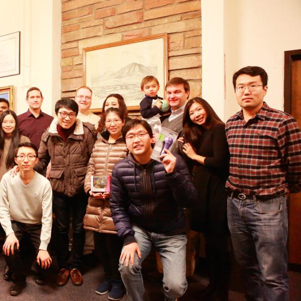 group gathering during a holiday party in fall 2015