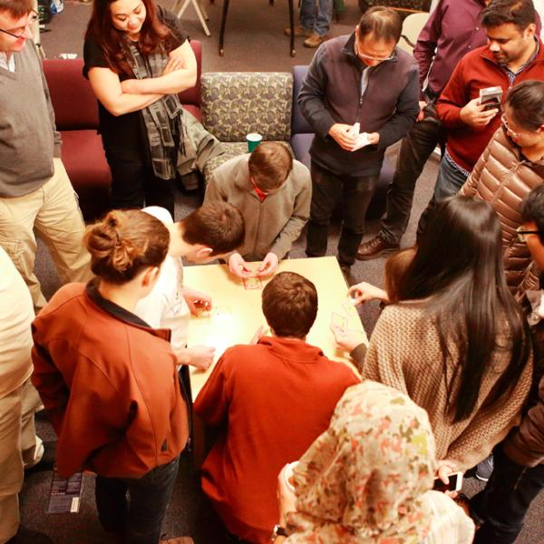 solving puzzles during a holiday party in fall 2015