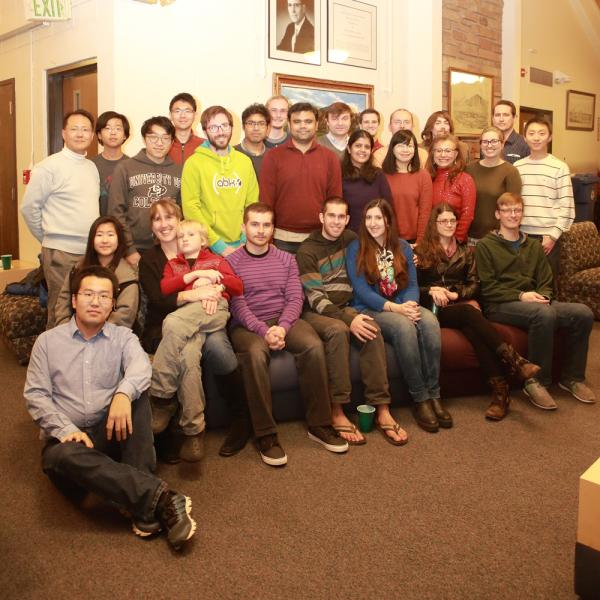 a group photo at a holidays party in december of 2016