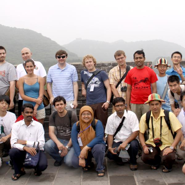 Photo of group members and other attendees at the Great Wall of China in 2009