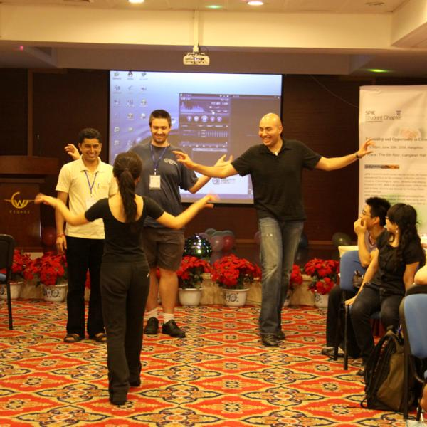 Julian Evans and Dennis Gardner are learning how to dance during the SPIE student chapters activities during I-CAMP 2009 in Hangzhou, China