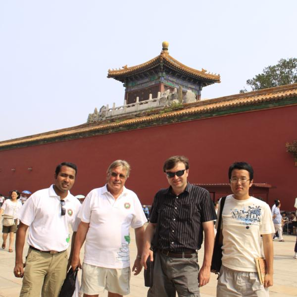 Rajdeep Deb, Harry Coles, Ivan Smalyukh and Qingkun Liu in the streets of Beijing during I-CAMP 2009 in China