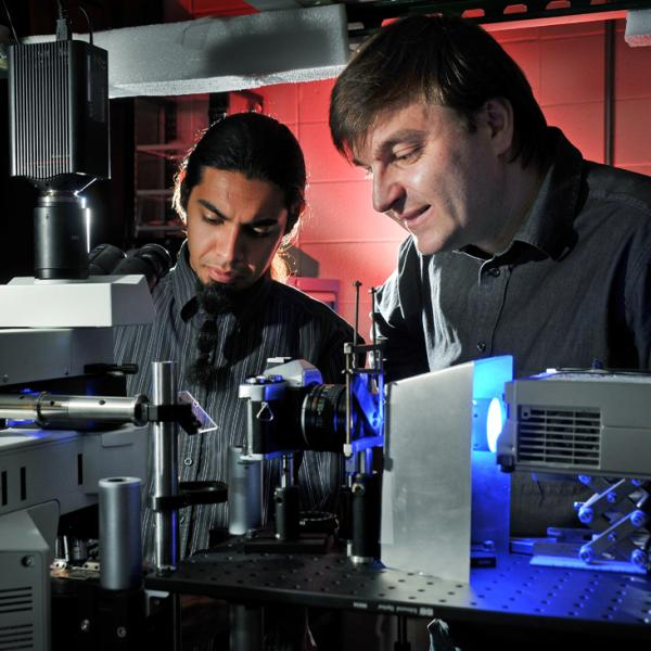 Ivan Smalyukh and Angel Martinez working in the lab in 2009