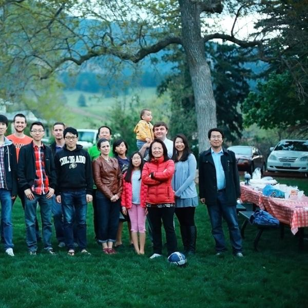members are happy at a group BBQ in spring 2015