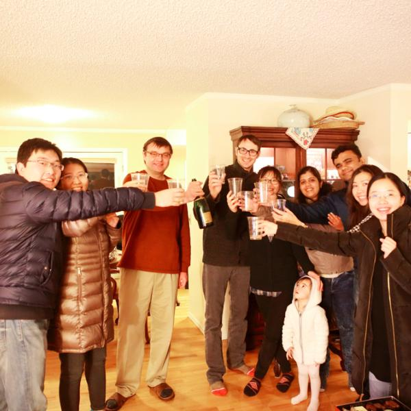cheers at a holiday party in winter 2016