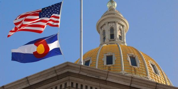 Capitol building with America and Colorado flags