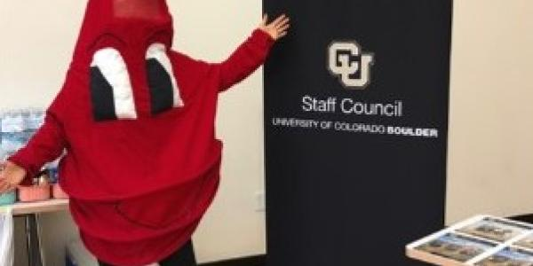 Blood drop mascot next to the Staff Council sign