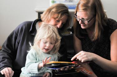 Child and two women reading