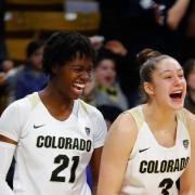 CU Women's basketball players cheering