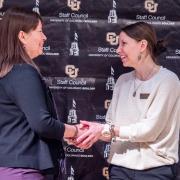 Staff shaking hands