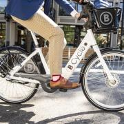 Businessperson riding a B-Cycle