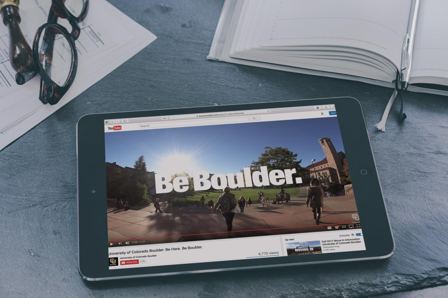 CU Boulder YouTube Channel showing on a tablet