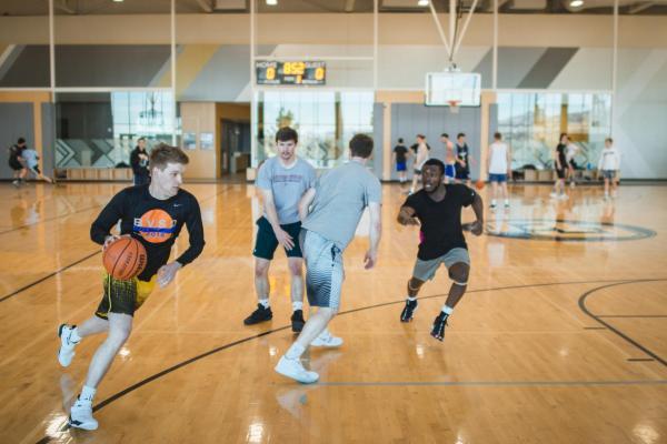 People playing basketball indoors