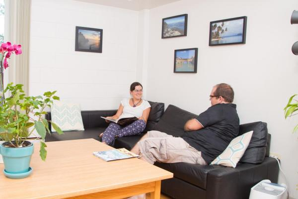 Two people lounging in their living room
