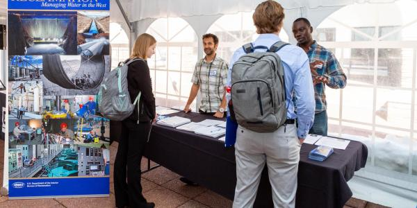 Students talking to employers at a career fair