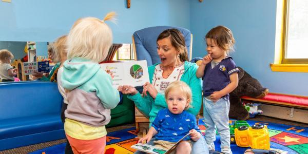 Teacher reading to small children
