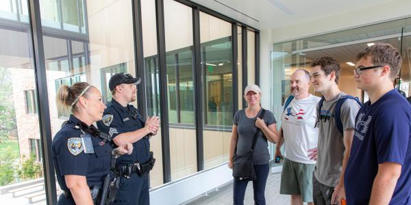 CUPD officers interacting with CU family