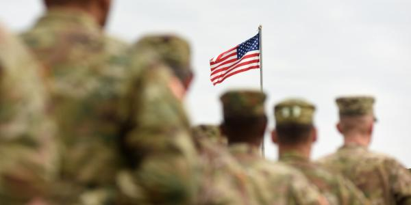 Soldiers with flag in the background