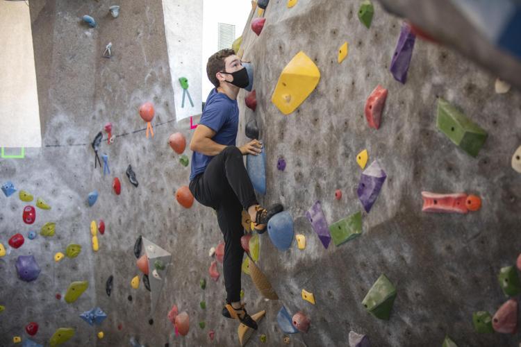student climbing at rec center