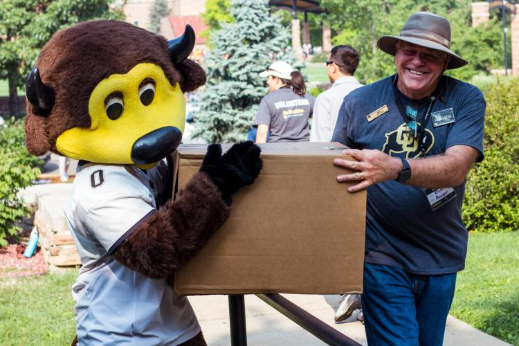chip and volunteer during move-in