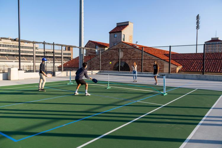 students playing tennis in masks