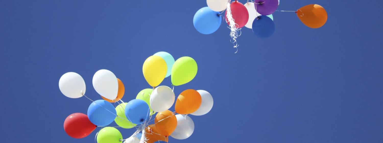 balloons floating in blue sky