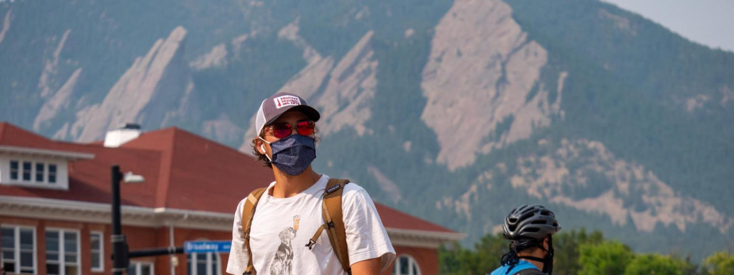 student wearing mask on campus