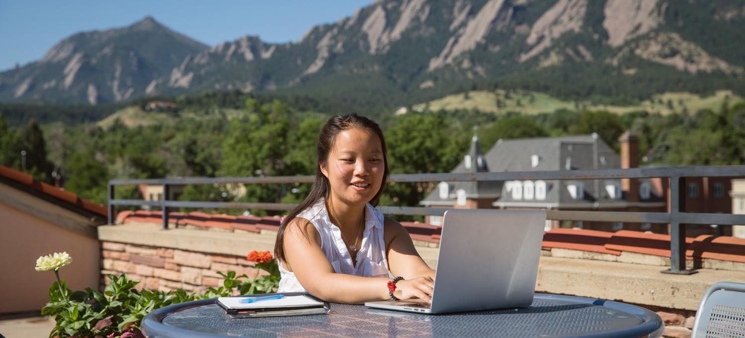 A female student studies on the roof of the UMC.