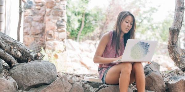 Student works on her laptop at Boulder Creek.