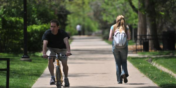 Students walking and biking across campus