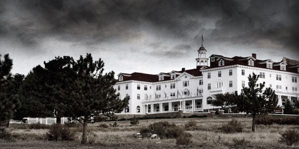 Black and white exterior of the Stanley Hotel.