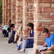 Students studying outside in the summer.