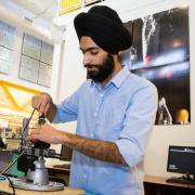 International graduate student, Snehpal Singh Saini, photographed in the telecommunications lab at CU Boulder.