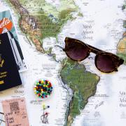 Image of map with sunglasses and a passport