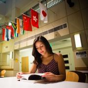 Haelena Bondi-Camacho sitting in the library.
