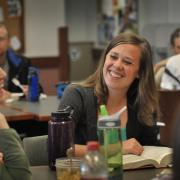 Two law students work together at a table.