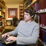 Summer Session student, Chase Pennoyer in the Nolan Library