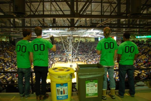 Ralphie's Green Stampede student volunteers at a CU basketball game.