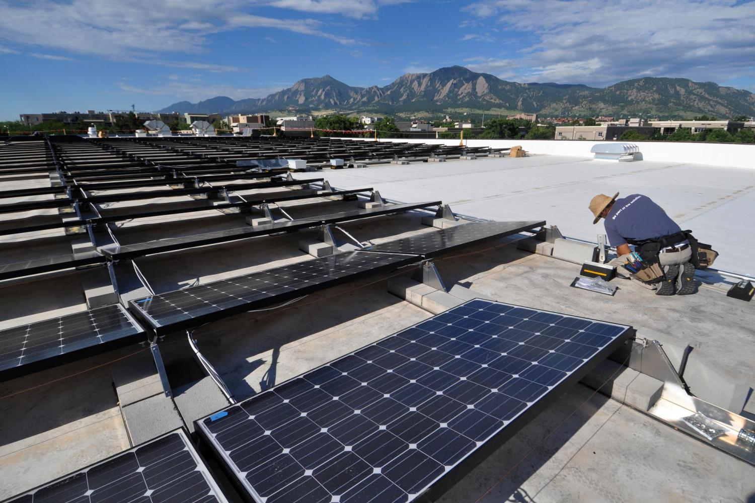 solar panels with flatirons in the background