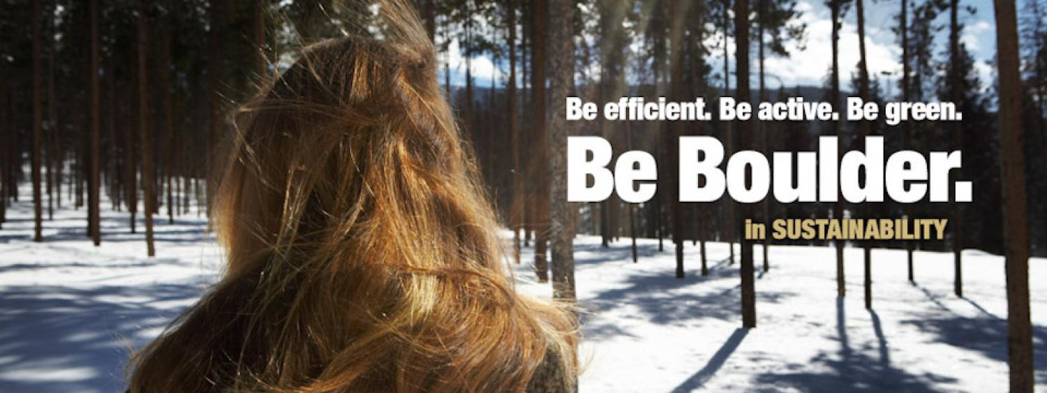 Student in snowy forest: Be Boulder